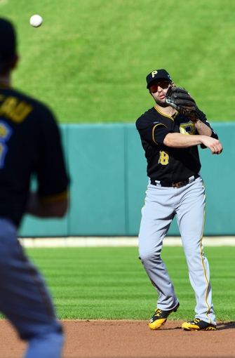 Oct 3, 2013; St. Louis, MO, USA; Pittsburgh Pirates second baseman Neil Walker (18) throws to first base against the St. Louis Cardinals in game one of the National League divisional series playoff baseball game at Busch Stadium. Mandatory Credit: Scott Rovak-USA TODAY Sports