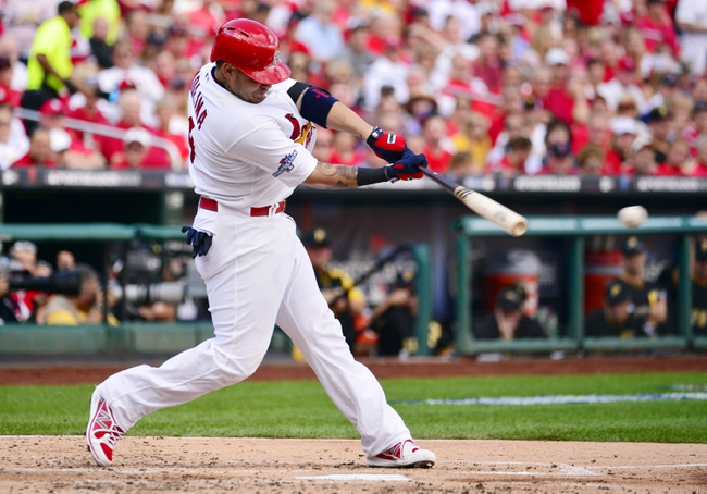 Oct 3, 2013; St. Louis, MO, USA; St. Louis Cardinals right fielder Carlos Beltran hits a single against the Pittsburgh Pirates in the second inning in game one of the National League divisional series playoff baseball game at Busch Stadium. Mandatory Credit: Scott Rovak-USA TODAY Sports