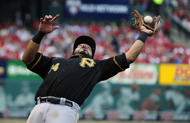 Oct 3, 2013; St. Louis, MO, USA; Pittsburgh Pirates third baseman Pedro Alvarez (24) catches a foul ball hit by St. Louis Cardinals right fielder Carlos Beltran (not pictured) during the fourth inning in game one of the National League divisional series playoff baseball game at Busch Stadium. St. Louis defeated Pittsburgh 9-1. Mandatory Credit: Jeff Curry-USA TODAY Sports