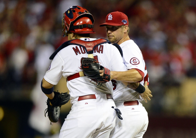 Oct 3, 2013; St. Louis, MO, USA; St. Louis Cardinals catcher Yadier Molina (4) celebrates with relief pitcher Trevor Rosenthal (26) after defeating the Pittsburgh Pirates in game one of the National League divisional series playoff baseball game at Busch Stadium. St. Louis defeated Pittsburgh 9-1. Mandatory Credit: Jeff Curry-USA TODAY Sports