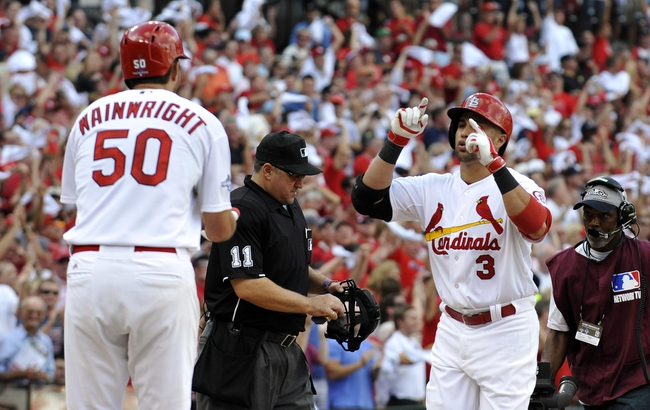 Oct 3, 2013; St. Louis, MO, USA; St. Louis Cardinals right fielder Carlos Beltran (3) celebrates with starting pitcher Adam Wainwright (50) after hitting a three-run home run against the Pittsburgh Pirates during the third inning in game one of the National League divisional series playoff baseball game at Busch Stadium. The Cardinals derated the Pirates 9-1. Mandatory Credit: Scott Rovak-USA TODAY Sports