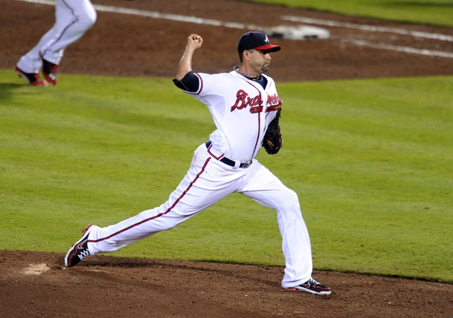 Oct 3, 2013; Atlanta, GA, USA; Atlanta Braves relief pitcher Luis Ayala (20) throws against the Los Angeles Dodgers during the fifth inning of game one of the National League divisional series playoff baseball game at Turner Field. Mandatory Credit: Dale Zanine-USA TODAY Sports