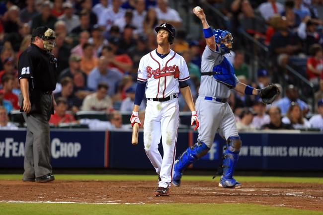 Oct 3, 2013; Atlanta, GA, USA; Atlanta Braves shortstop Andrelton Simmons (19) reacts after striking out in the seventh inning of game one of the National League divisional series playoff baseball game against the Los Angeles Dodgers at Turner Field. Mandatory Credit: Daniel Shirey-USA TODAY Sports