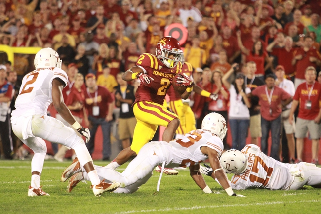 Oct 3, 2013; Ames, IA, USA;  Iowa State Cyclones running back Aaron Wimberly (2) runs past the Texas Longhorns safety Mykkele Thompason (2), cornerback Carrington Byndom (23) and safety Adrian Phillips (17) during the fourth quarter at Jack Trice Stadium. Texas beat Iowa State 31-30.   Mandatory Credit: Reese Strickland-USA TODAY Sports