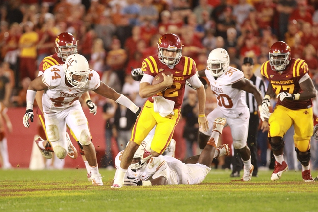 Oct 3, 2013; Ames, IA, USA; Texas Longhorns linebackers Jackson Jeffcoat (44) and Timothy Cole (30) chase Iowa State Cyclones quarterback Sam Richardson (12) during the fourth quarter at Jack Trice Stadium. Texas beat Iowa State 31-30.   Mandatory Credit: Reese Strickland-USA TODAY Sports