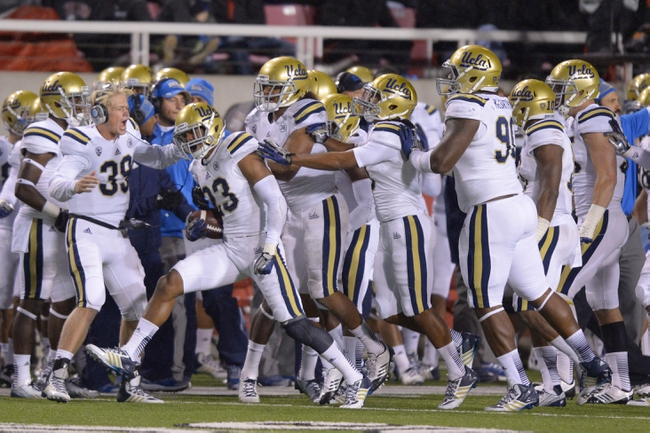 Oct 3, 2013; Salt Lake City, UT, USA; UCLA Bruins defensive back Anthony Jefferson (23) celebrates with teammates after intercepting a pass in the final minute against the Utah Utes at Rice-Eccles Stadium. UCLA defeated Utah 34-27. Mandatory Credit: Kirby Lee-USA TODAY Sports