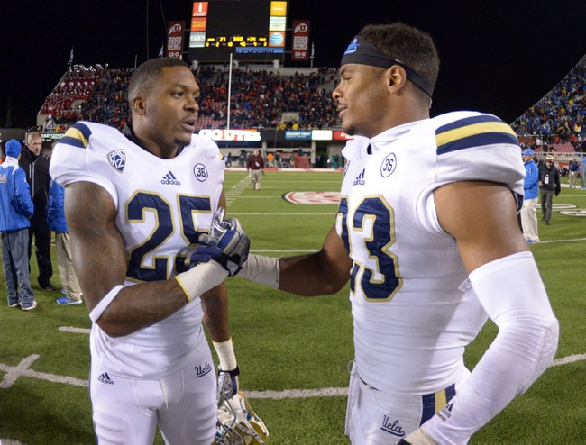 Oct 3, 2013; Salt Lake City, UT, USA; UCLA Bruins safety Brandon Sermons (25) and defensive back Anthony Jefferson (23) shake hands after the game against the Utah Utes at Rice-Eccles Stadium. UCLA defeated Utah 34-27. Mandatory Credit: Kirby Lee-USA TODAY Sports
