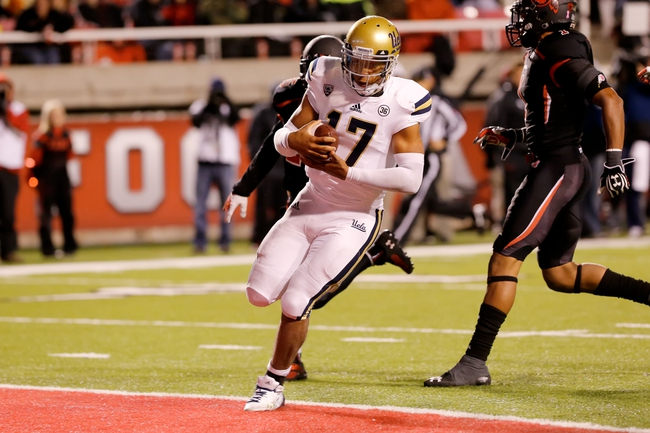 Oct 3, 2013; Salt Lake City, UT, USA; UCLA Bruins quarterback Brett Hundley (17) runs the ball into the end zone for a 36 yard touchdown run in the 4th quarter against the Utah Utes at Rice-Eccles Stadium. UCLA Bruins won 34-27 over the Utah Utes. Mandatory Credit: Chris Nicoll-USA TODAY Sports