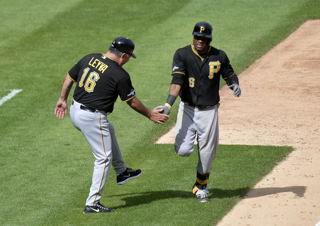 Oct 4, 2013; St. Louis, MO, USA; Pittsburgh Pirates left fielder Starling Marte (6) is congratulated by third base coach Nick Leyva (16) after a solo home run against the St. Louis Cardinals in the 8th inning in game two of the National League divisional series playoff baseball game at Busch Stadium. Mandatory Credit: Jasen Vinlove-USA TODAY Sports