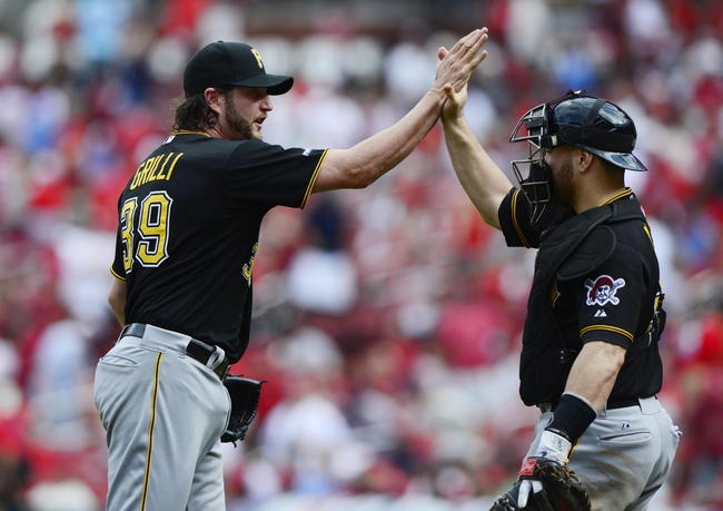 Oct 4, 2013; St. Louis, MO, USA; Pittsburgh Pirates relief pitcher Jason Grilli (39) shakes hands with catcher Russell Martin (right) after game two of the National League divisional series playoff baseball game against the St. Louis Cardinals at Busch Stadium. Mandatory Credit: Jeff Curry-USA TODAY Sports