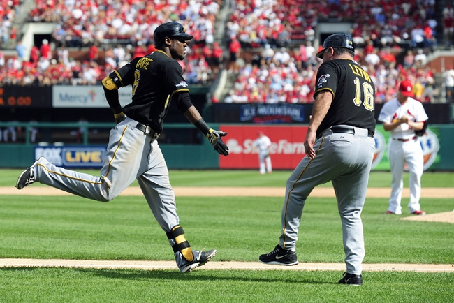 Oct 4, 2013; St. Louis, MO, USA; Pittsburgh Pirates left fielder Starling Marte (left) is congratulated by third base coach Nick Leyva (16) after hitting a solo home run off of St. Louis Cardinals starting pitcher Shelby Miller (background right) during the eighth inning in game two of the National League divisional series playoff baseball game at Busch Stadium. Pittsburgh defeated St. Louis 7-1. Mandatory Credit: Jeff Curry-USA TODAY Sports