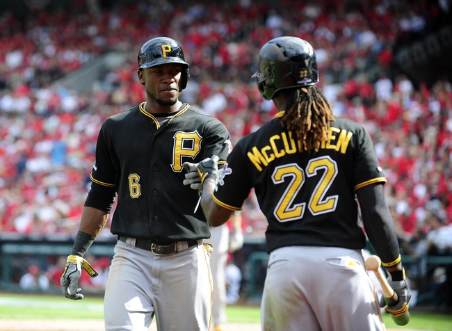 Oct 4, 2013; St. Louis, MO, USA; Pittsburgh Pirates left fielder Starling Marte (6) is congratulated by center fielder Andrew McCutchen (22) after hitting a solo home run off of St. Louis Cardinals starting pitcher Shelby Miller (not pictured) during the eighth inning in game two of the National League divisional series playoff baseball game at Busch Stadium. Pittsburgh defeated St. Louis 7-1. Mandatory Credit: Jeff Curry-USA TODAY Sports