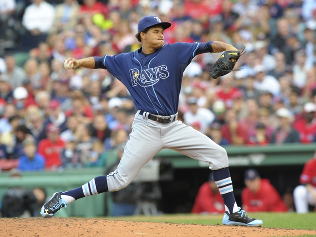 Oct 4, 2013; Boston, MA, USA; Tampa Bay Rays relief pitcher Chris Archer (22) pitches during the fifth inning in game one of the American League divisional series playoff baseball game against the Boston Red Sox at Fenway Park. Mandatory Credit: Bob DeChiara-USA TODAY Sports