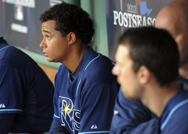 Oct 4, 2013; Boston, MA, USA; Tampa Bay Rays relief pitcher Chris Archer (22) sits in the dugout during the seventh in game one of the American League divisional series playoff baseball game against the Boston Red Sox at Fenway Park. Mandatory Credit: Bob DeChiara-USA TODAY Sports