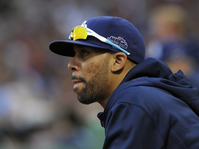 Oct 4, 2013; Boston, MA, USA; Tampa Bay Rays pitcher David Price (14) watches the action from the dugout during the eighth inning  in game one of the American League divisional series playoff baseball game against the Boston Red Sox at Fenway Park. Mandatory Credit: Bob DeChiara-USA TODAY Sports