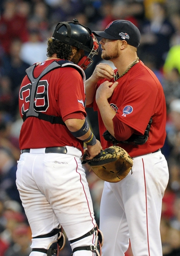 Oct 4, 2013; Boston, MA, USA; Boston Red Sox catcher Jarrod Saltalamacchia (39) talks with starting pitcher Jon Lester (31) during the eighth inning in game one of the American League divisional series playoff baseball game against the Tampa Bay Rays at Fenway Park. Mandatory Credit: Bob DeChiara-USA TODAY Sports