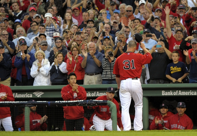 Oct 4, 2013; Boston, MA, USA; Boston Red Sox starting pitcher Jon Lester (31) tips his cap to the fans after being relieved during the eighth inning in game one of the American League divisional series playoff baseball game against the Tampa Bay Rays at Fenway Park. Mandatory Credit: Bob DeChiara-USA TODAY Sports