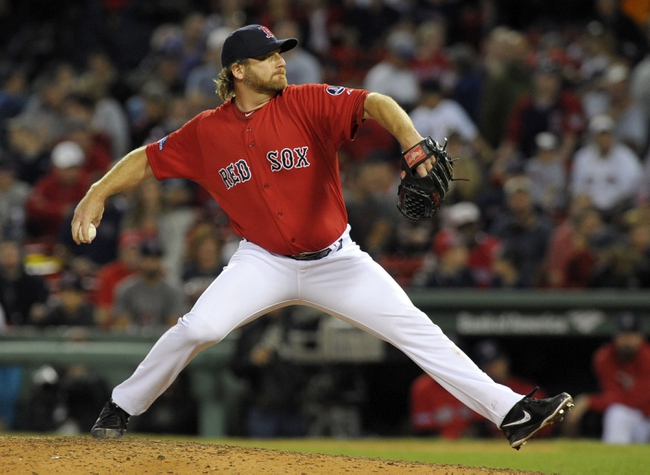 Oct 4, 2013; Boston, MA, USA; Boston Red Sox relief pitcher Ryan Dempster (46) pitches during the ninth inning in game one of the American League divisional series playoff baseball game against the Tampa Bay Rays at Fenway Park. Mandatory Credit: Bob DeChiara-USA TODAY Sports