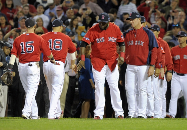 Oct 4, 2013; Boston, MA, USA; Members of the Boston Red Sox celebrate after defeating the Tampa Bay Rays in game one of the American League divisional series playoff baseball game at Fenway Park. Mandatory Credit: Bob DeChiara-USA TODAY Sports
