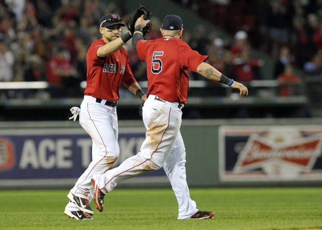Oct 4, 2013; Boston, MA, USA; Boston Red Sox center fielder Jacoby Ellsbury (left) high fives left fielder Jonny Gomes (5) after defeating the Tampa Bay Rays in game one of the American League divisional series playoff baseball game at Fenway Park. Mandatory Credit: Bob DeChiara-USA TODAY Sports