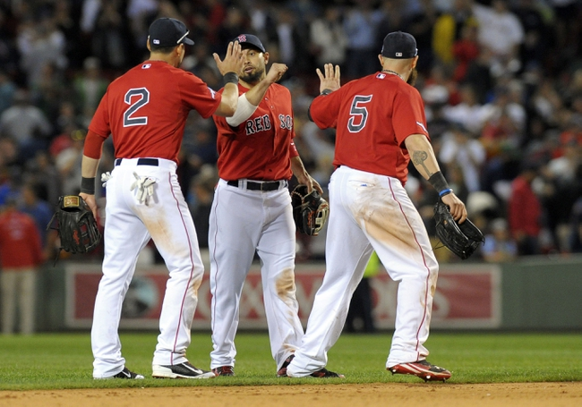 Oct 4, 2013; Boston, MA, USA; Boston Red Sox center fielder Jacoby Ellsbury (2), right fielder Shane Victorino (middle) and left fielder Jonny Gomes (5) celebrate after defeating the Tampa Bay Rays in game one of the American League divisional series playoff baseball game at Fenway Park. Mandatory Credit: Bob DeChiara-USA TODAY Sports