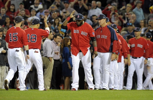 Oct 4, 2013; Boston, MA, USA; Members of the Boston Red Sox including David Ortiz (middle) celebrate after defeating the Tampa Bay Rays in game one of the American League divisional series playoff baseball game at Fenway Park. Mandatory Credit: Bob DeChiara-USA TODAY Sports