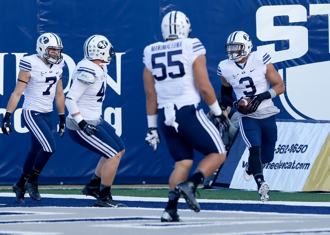 Oct 4, 2013; Logan, UT, USA; Brigham Young Cougars linebacker Kyle Van Noy (3) defensive back Skye PoVey (7) defensive back Robertson Daniel (4) and defensive lineman Eathyn Manumaleuna (55) celebrate after Van Noy intercepts the ball and scores a touchdown on Utah State Aggies first play of the game at Romney Stadium. Mandatory Credit: Chris Nicoll-USA TODAY Sports