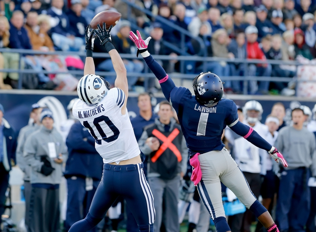 Oct 4, 2013; Logan, UT, USA; Brigham Young Cougars wide receiver Mitch Mathews (10) catches the ball while Utah State Aggies cornerback Nevin Lawson (1) tries to defend against the pass during the first quarter at Romney Stadium. Mandatory Credit: Chris Nicoll-USA TODAY Sports