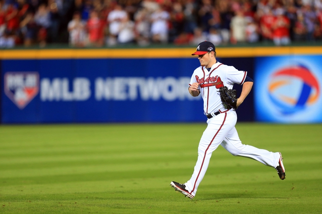 Oct 4, 2013; Atlanta, GA, USA; Atlanta Braves relief pitcher Craig Kimbrel (46) comes into the game against the Los Angeles Dodgers in the eighth inning of game two of the National League divisional series playoff baseball game at Turner Field. Mandatory Credit: Daniel Shirey-USA TODAY Sports
