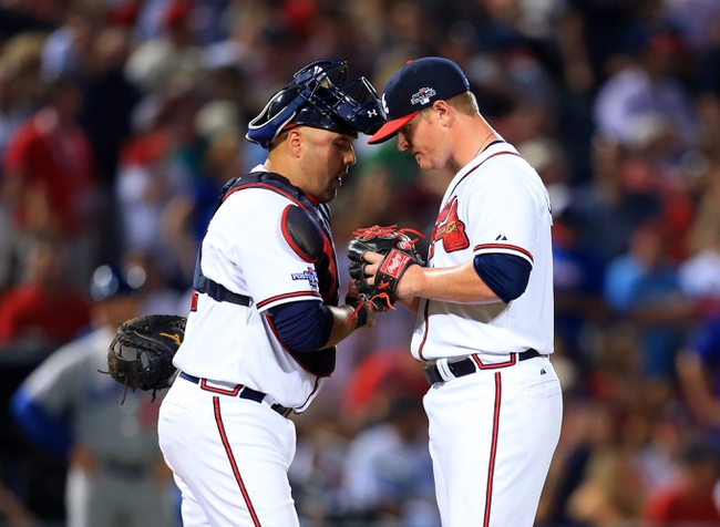 Oct 4, 2013; Atlanta, GA, USA; Atlanta Braves catcher Gerald Laird (11) talks with relief pitcher David Carpenter (48) after giving up a home run to the Los Angeles Dodgers in the eighth inning of game two of the National League divisional series playoff baseball game at Turner Field. Mandatory Credit: Daniel Shirey-USA TODAY Sports
