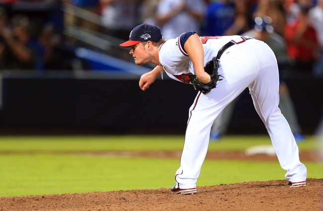 Oct 4, 2013; Atlanta, GA, USA; Atlanta Braves relief pitcher Craig Kimbrel (46) throws against the Los Angeles Dodgers during the ninth inning of game two of the National League divisional series playoff baseball game at Turner Field. The Braves won 4-3. Mandatory Credit: Daniel Shirey-USA TODAY Sports