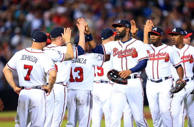 Oct 4, 2013; Atlanta, GA, USA; Atlanta Braves center fielder Jason Heyward (22) celebrates with teammates after defeating the Los Angeles Dodgers in game two of the National League divisional series playoff baseball game at Turner Field. The Braves won 4-3. Mandatory Credit: Daniel Shirey-USA TODAY Sports