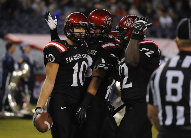 Oct 4, 2013; San Diego, CA, USA; San Diego State wide receiver Dylan Denso (10) celebrates after a touchdown reception during the first half against the Nevada Wolf Pack at Qualcomm Stadium. Mandatory Credit: Christopher Hanewinckel-USA TODAY Sports