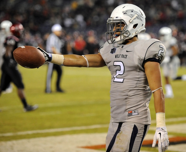 Oct 4, 2013; San Diego, CA, USA; Nevada Wolf Pack receiver Richy Turner (2) celebrates after scoring a touchdown during the second half against the San Diego State Aztecs at Qualcomm Stadium. Mandatory Credit: Christopher Hanewinckel-USA TODAY Sports