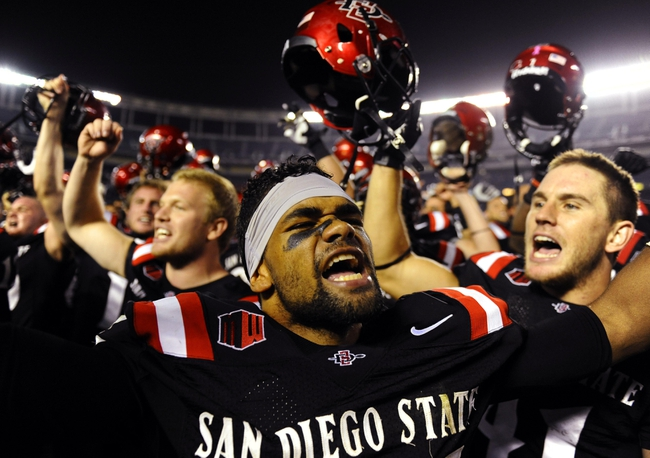 Oct 4, 2013; San Diego, CA, USA; San Diego State defensive back King Holder (35) celebrates with teammates following a 51-44 overtime win against the Nevada Wolf Pack at Qualcomm Stadium. Mandatory Credit: Christopher Hanewinckel-USA TODAY Sports