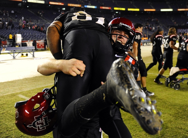 Oct 4, 2013; San Diego, CA, USA; San Diego State kicker Seamus McMorrow (17) celebrates with wide receiver Eric Judge (81) after a 51-44 overtime win against the Nevada Wolf Pack at Qualcomm Stadium. Mandatory Credit: Christopher Hanewinckel-USA TODAY Sports