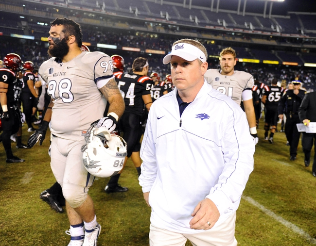 Oct 4, 2013; San Diego, CA, USA; Nevada Wolf Pack head coach Brian Polian walks off the field following a 51-44 overtime loss against the San Diego State Aztecs at Qualcomm Stadium. Mandatory Credit: Christopher Hanewinckel-USA TODAY Sports