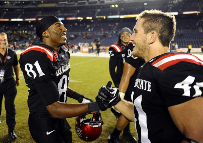 Oct 4, 2013; San Diego, CA, USA; San Diego State wide receiver Eric Judge (81) celebrates with receiver Tim Vizzi (41) after a 51-44 overtime win against the Nevada Wolf Pack at Qualcomm Stadium. Mandatory Credit: Christopher Hanewinckel-USA TODAY Sports