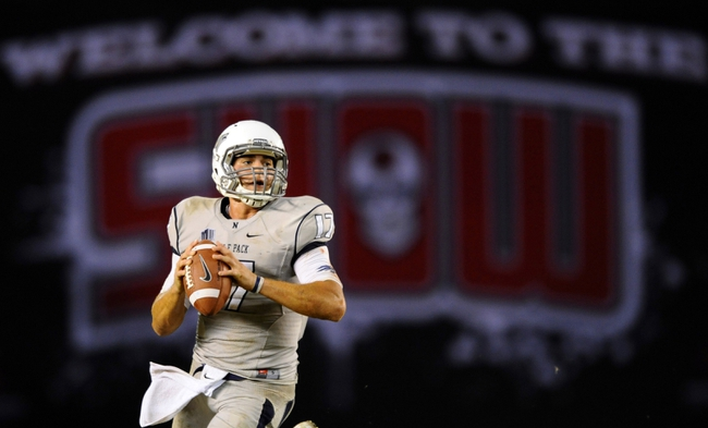 Oct 4, 2013; San Diego, CA, USA; Nevada Wolf Pack quarterback Cody Fajardo (17) drops back to pass during the second half against the San Diego State Aztecs at Qualcomm Stadium. Mandatory Credit: Christopher Hanewinckel-USA TODAY Sports