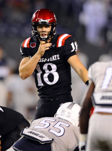 Oct 4, 2013; San Diego, CA, USA; San Diego State quarterback Quinn Kaehler (18) calls plays at the line during the second half against the Nevada Wolf Pack at Qualcomm Stadium. Mandatory Credit: Christopher Hanewinckel-USA TODAY Sports