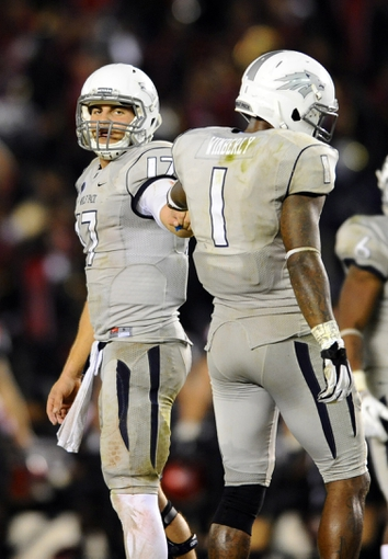 Oct 4, 2013; San Diego, CA, USA; Nevada Wolf Pack quarterback Cody Fajardo (17) and receiver Brandon Wimberly (1) during the second half against the San Diego State Aztecs at Qualcomm Stadium. Mandatory Credit: Christopher Hanewinckel-USA TODAY Sports