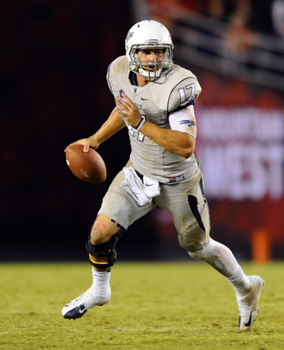Oct 4, 2013; San Diego, CA, USA; Nevada Wolf Pack quarterback Cody Fajardo (17) runs the ball during the second half against the San Diego State Aztecs at Qualcomm Stadium. Mandatory Credit: Christopher Hanewinckel-USA TODAY Sports