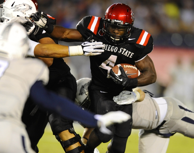 Oct 4, 2013; San Diego, CA, USA; San Diego State running back Adam Muema (4) runs for a short gain during the second half against the Nevada Wolf Pack at Qualcomm Stadium. Mandatory Credit: Christopher Hanewinckel-USA TODAY Sports