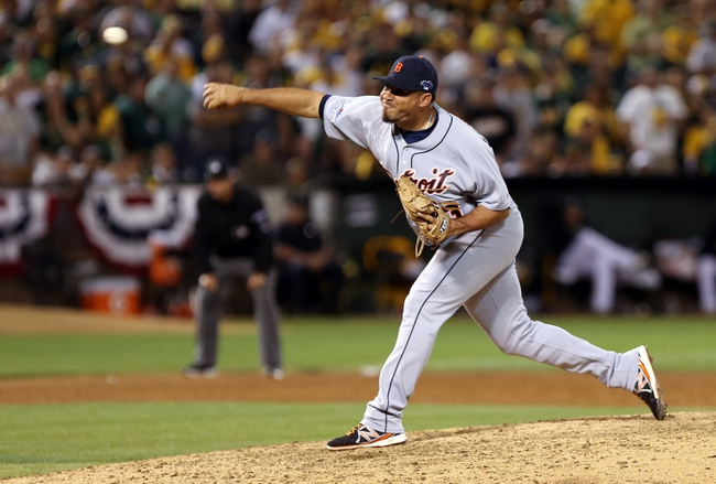 Oct 4, 2013; Oakland, CA, USA; Detroit Tigers relief pitcher Joaquin Benoit (53) pitches the ball against the Oakland Athletics during the ninth inning in game one of the American League divisional series playoff baseball game at O.co Coliseum. The Detroit Tigers defeated the Oakland Athletics 3-2. Mandatory Credit: Kelley L Cox-USA TODAY Sports