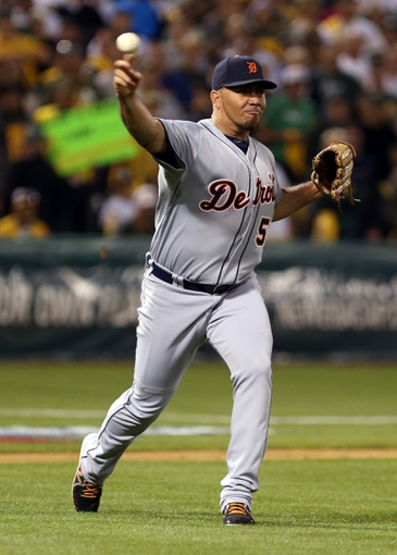 Oct 4, 2013; Oakland, CA, USA; Detroit Tigers relief pitcher Joaquin Benoit (53) throws the ball to first base against the Oakland Athletics during the ninth inning in game one of the American League divisional series playoff baseball game at O.co Coliseum. The Detroit Tigers defeated the Oakland Athletics 3-2. Mandatory Credit: Kelley L Cox-USA TODAY Sports