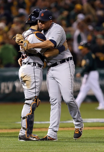 Oct 4, 2013; Oakland, CA, USA; Detroit Tigers relief pitcher Joaquin Benoit (53) celebrates with catcher Alex Avila (13) after the win against the Oakland Athletics in game one of the American League divisional series playoff baseball game at O.co Coliseum. The Detroit Tigers defeated the Oakland Athletics 3-2. Mandatory Credit: Kelley L Cox-USA TODAY Sports