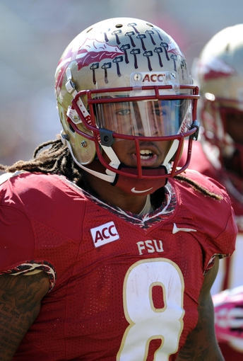 Oct 5, 2013; Tallahassee, FL, USA; Florida State Seminoles running back Devonta Freeman (8) warms up before the start of the game against the Maryland Terrapins at Doak Campbell Stadium. Mandatory Credit: Melina Vastola-USA TODAY Sports