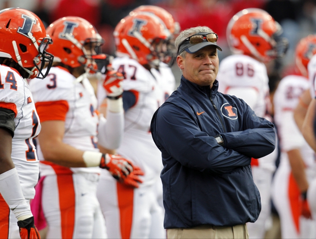 Oct 5, 2013; Lincoln, NE, USA; Illinois Fighting Illini head coach Tim Beckman watches his team before the game against the Nebraska Cornhuskers at Memorial Stadium. Mandatory Credit: Bruce Thorson-USA TODAY Sports