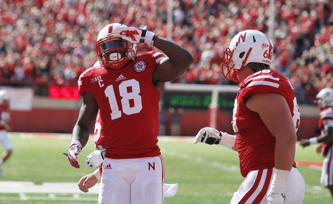 Oct 5, 2013; Lincoln, NE, USA; Nebraska Cornhuskers receiver Quincy Enunwa (18) salutes after scoring a touchdown against the Illinois Fighting Illini during the first quarter at Memorial Stadium. Mandatory Credit: Bruce Thorson-USA TODAY Sports