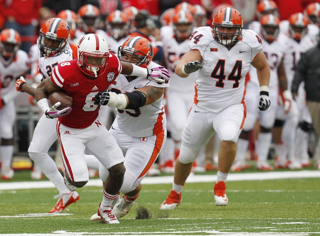 Oct 5, 2013; Lincoln, NE, USA; Nebraska Cornhuskers running back Ameer Abdullah (8) breaks away for a touchdown against Illinois Fighting Illini defender Jake Howe (95) during the third quarter at Memorial Stadium. Mandatory Credit: Bruce Thorson-USA TODAY Sports
